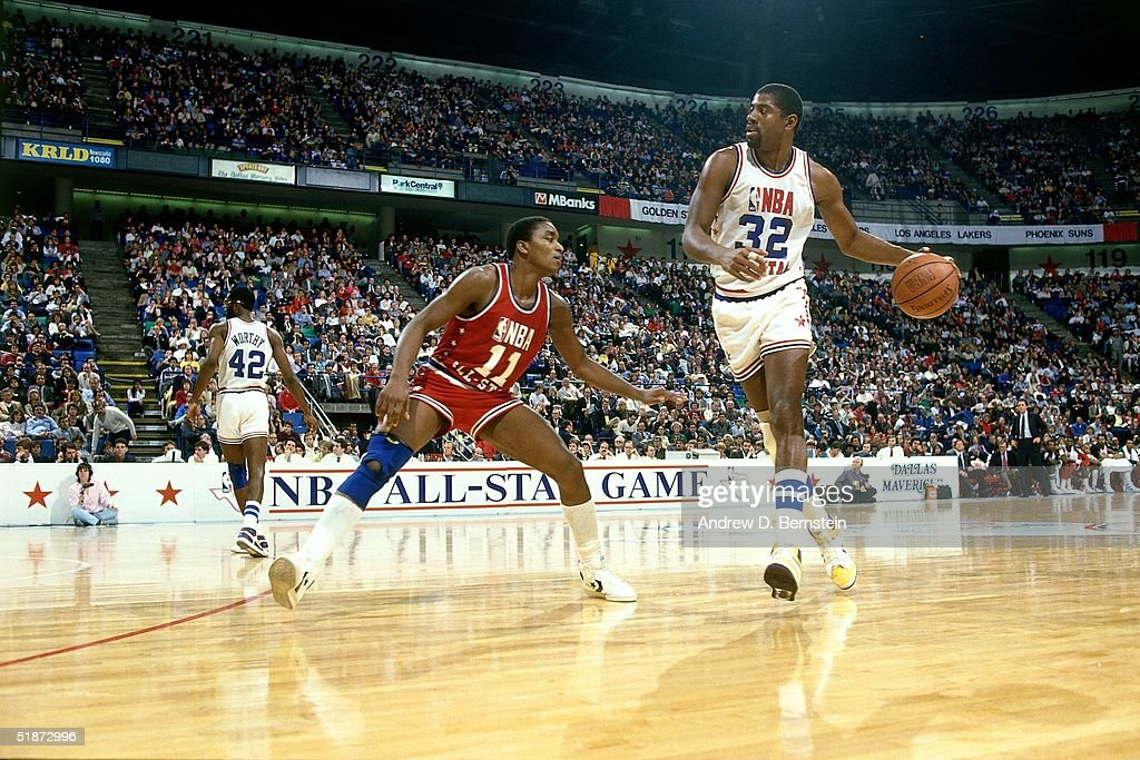 Magic Johnson #32 of the Western Conference All-Stars looks to make a play against the Eastern Conference All-Stars during the 1986 NBA All-Star Game on February 9, 1986 in Dallas, Texas.