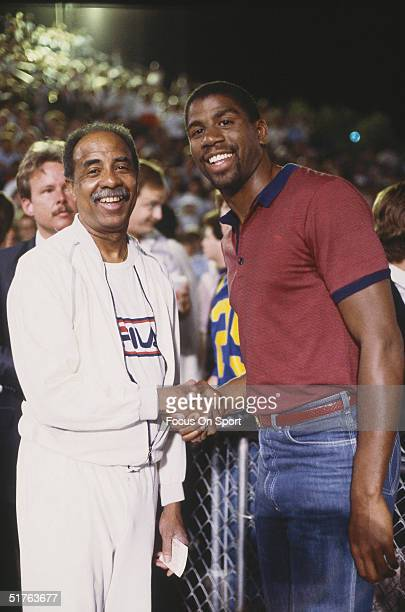 Magic Johnson poses for the camera with his father