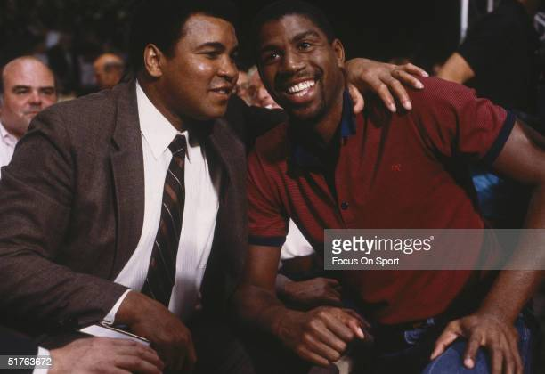 Magic Johnson poses for the camera with Muhammad Ali
