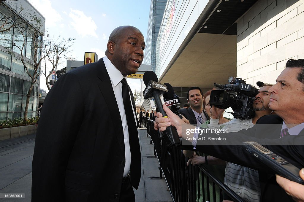 Magic Johnson speaks with the media before the memorial service for Los Angeles Lakers Owner Dr. Jerry Buss at Nokia Theatre LA LIVE on February 21, 2013 in Los Angeles, California.
