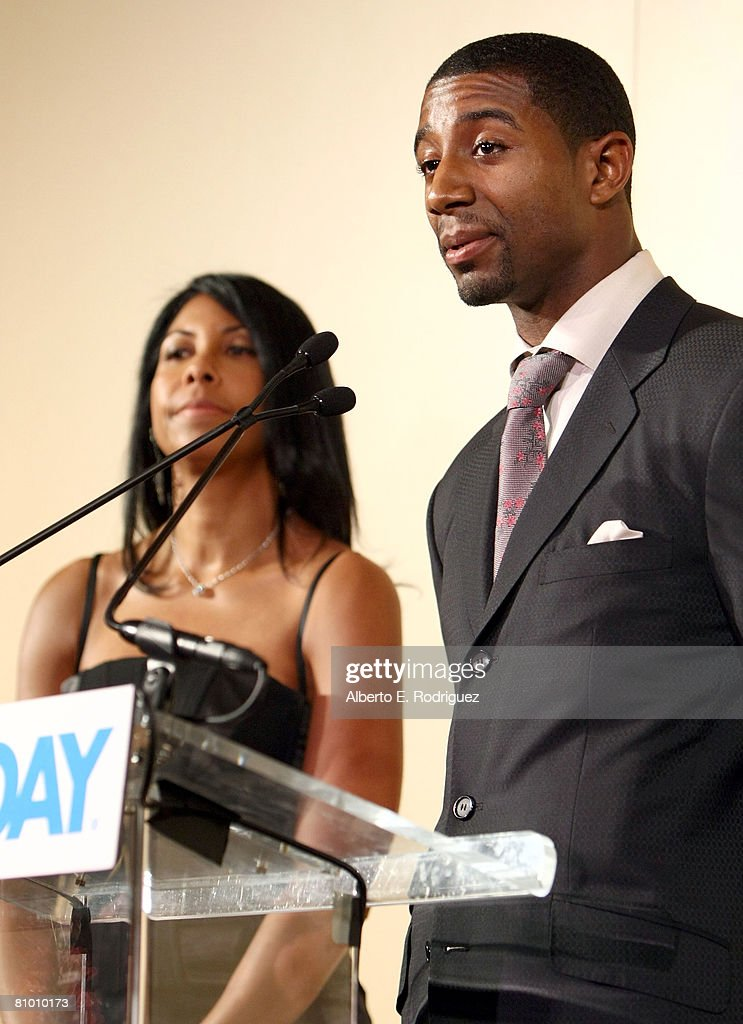 Magic Johnson's son Andre Johnson speaks as Cookie Johnson looks on during the USA TODAY Hollywood Hero honoring Magic Johnson at the Beverly Hills Hotel on May 6, 2008 in Los Angeles, California.