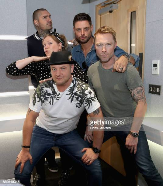 Magic Radio Breakfast presenter Ronan Keating poses with Keith Duffy Mikey Graham and Shane Lynch and travel presenter Eloise Carr as they recreate...