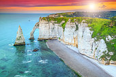 Stunning cliffs Aval of Etretat with beautiful famous coastline and wonderful sunset,Normandy,France,Europe