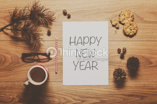 magical new year theme background on wooden table stock photo
