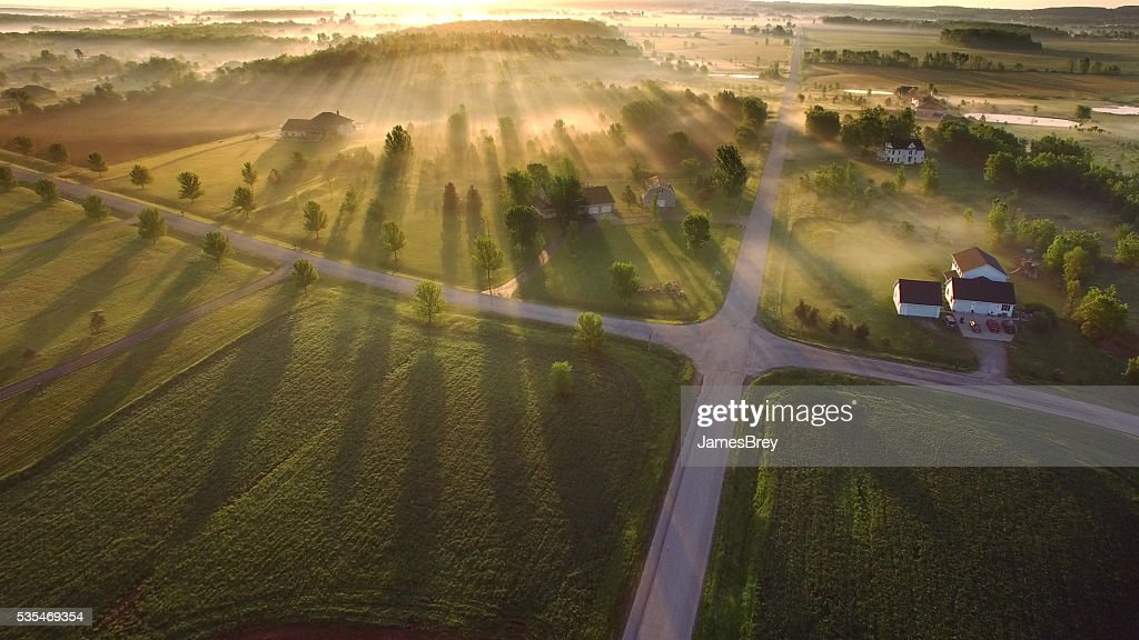 Magical sunrise through ground fog with long shadows and sunbeams : Stock Photo