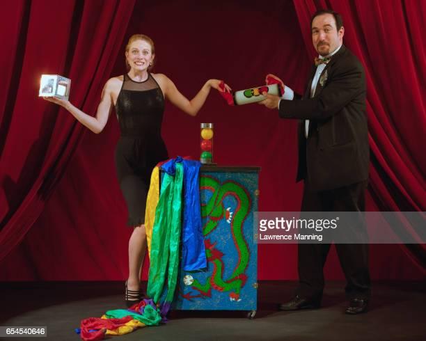 Magician and Assistant Performing Magic Trick