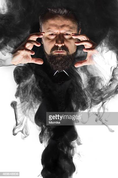 Magician appearing out of smoke