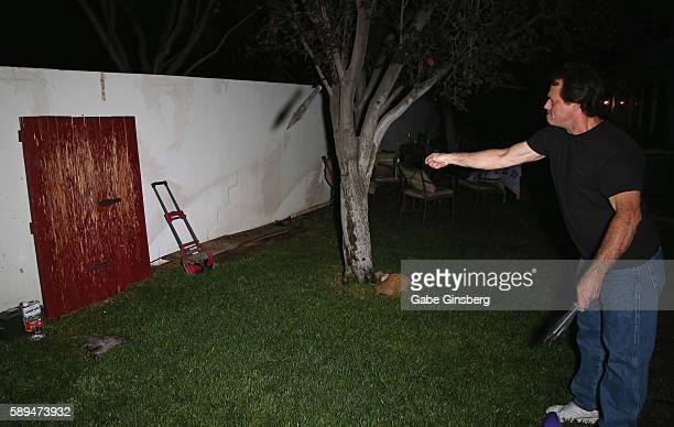 Magician Chuck Crespo throws a knife during the 2016 Amazing Magic Live party at private residence on August 13 2016 in Las Vegas Nevada