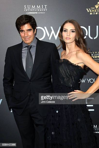 Magician David Copperfield and Chloe Gosselin attend Summit Entertainment presents the world premiere of 'Now You See Me 2' at AMC Loews Lincoln...