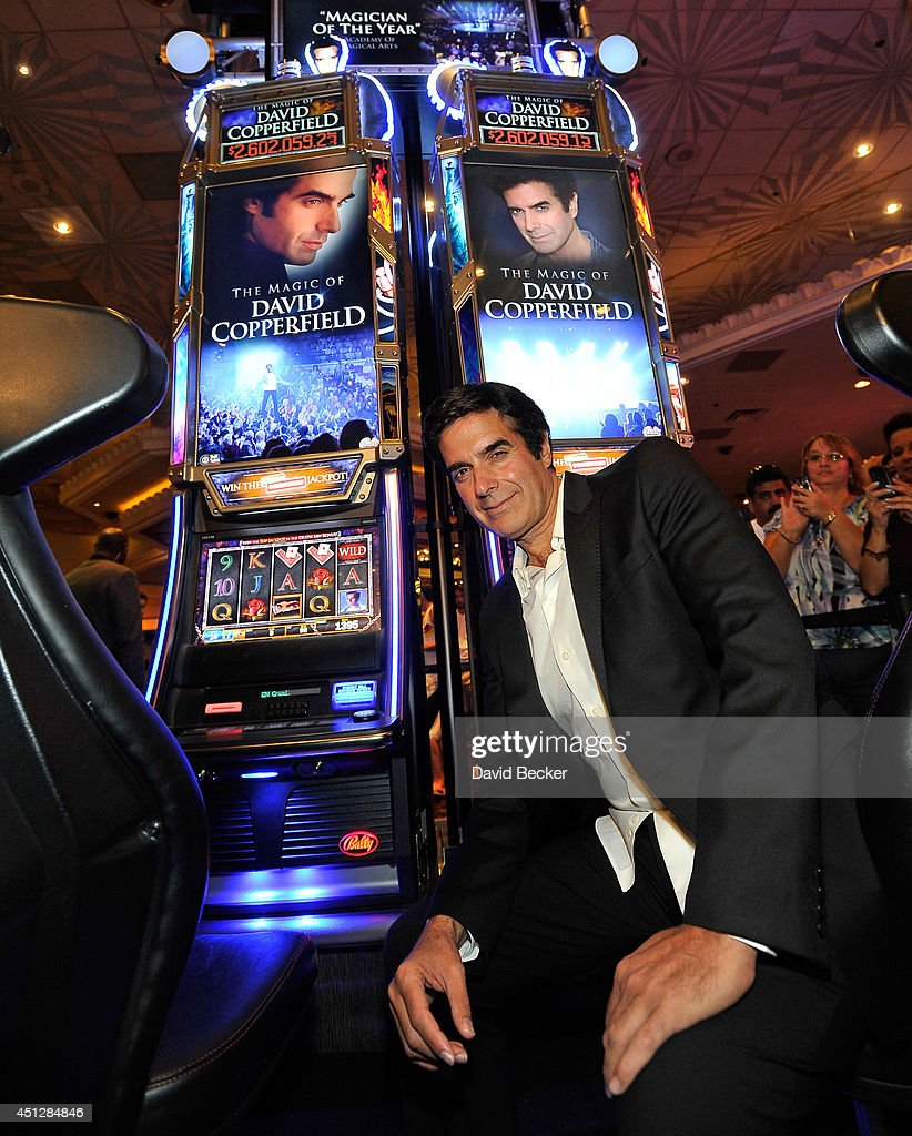 david copperfield slot machine unveiling at the mgm grand photos magician david copperfield appears a new slot machine the magic of david copperfield