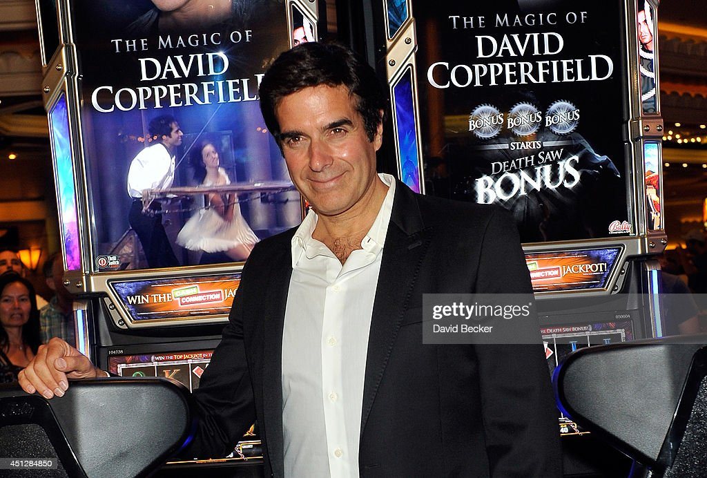 Magician David Copperfield appears with a new slot machine, 'The Magic of David Copperfield,' by Bally Technologies during the unveiling at the MGM Grand Hotel/Casino on June 26, 2014 in Las Vegas, Nevada.