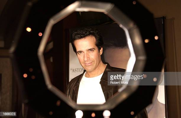 Magician David Copperfield poses for a photograph prior to performing at 'The Magic of David Copperfield' at the Kodak Theatre on November 29 2002 in...