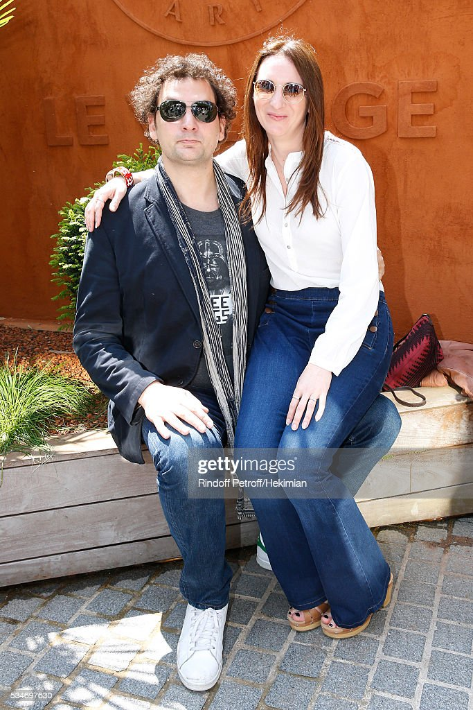 Magician Eric Antoine and his Australian companion Calista attend the 2016 French Tennis Open - Day Six at Roland Garros on May 27, 2016 in Paris, France.