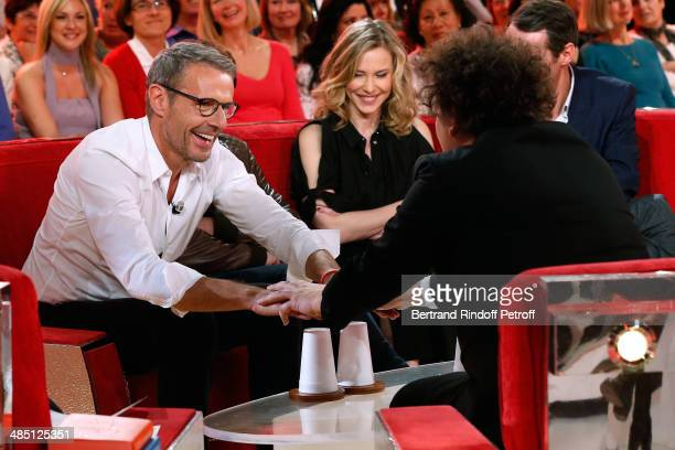 Magician Eric Antoine makes a sleight of hand to Lambert Wilson and Pascale Arbillot at the 'Vivement Dimanche' French TV Show Held at Pavillon...