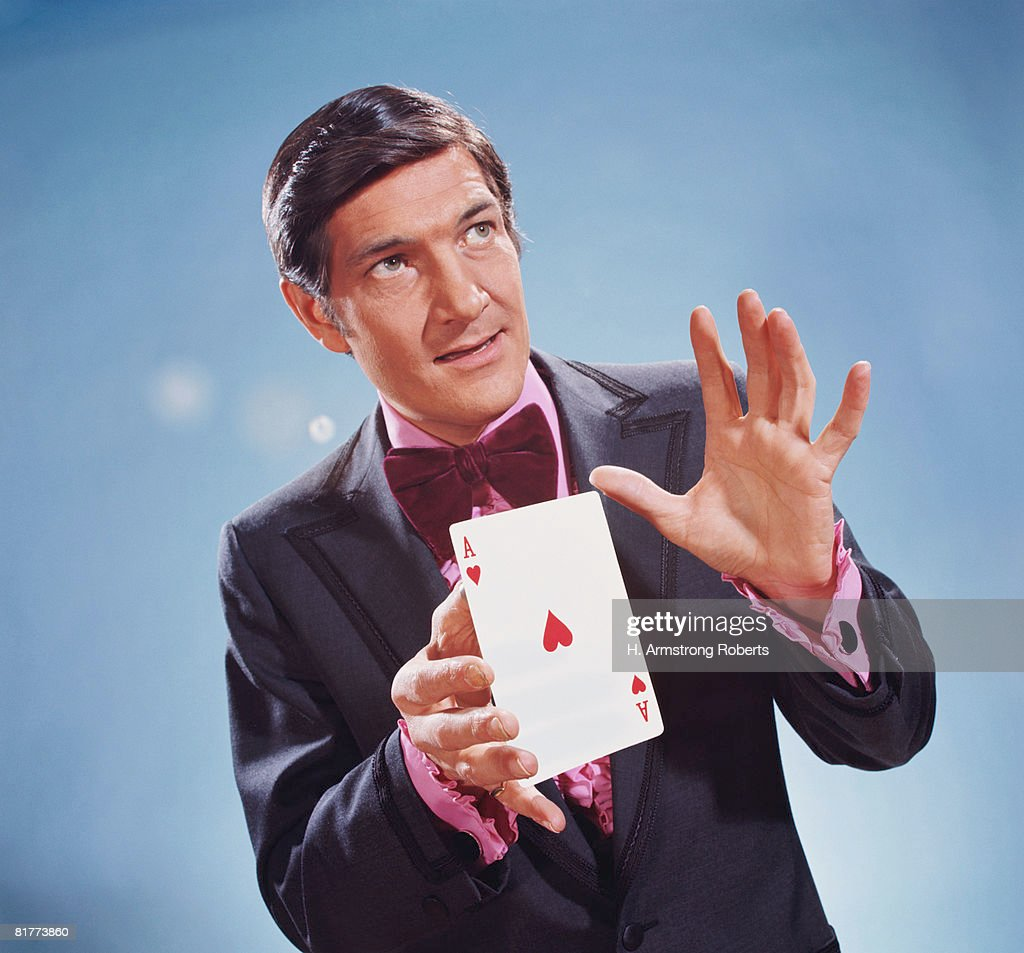Magician holding oversize ace of hearts in his hands. (Photo by H. Armstrong Roberts/Retrofile/Getty Images) : Stock Photo