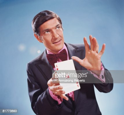 Magician holding oversize ace of hearts in his hands. (Photo by H. Armstrong Roberts/Retrofile/Getty Images)