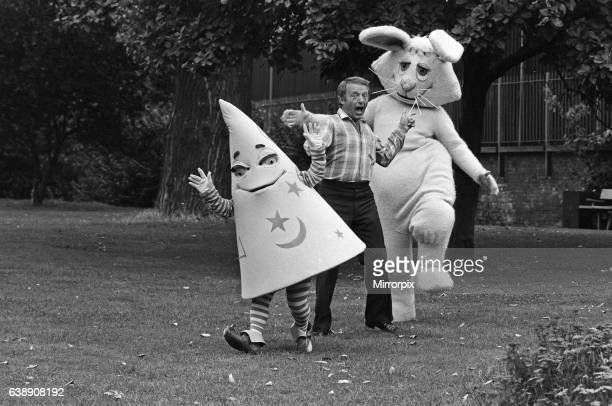 Magician Paul Daniels with his costars in the Children's BBC programme 'Wizbit' He is pictured with Wizbit a strange magical creature who looks like...