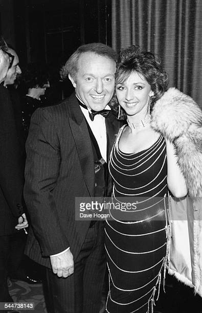 Magician Paul Daniels with his girlfriend and assistant Debbie McGee attending the Royal Variety Show London circa 1987