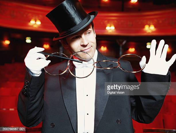 Magician performing trick on stage