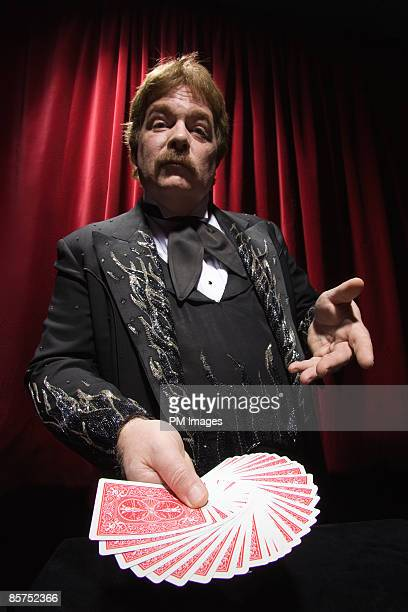 Magician playing Pick a card.