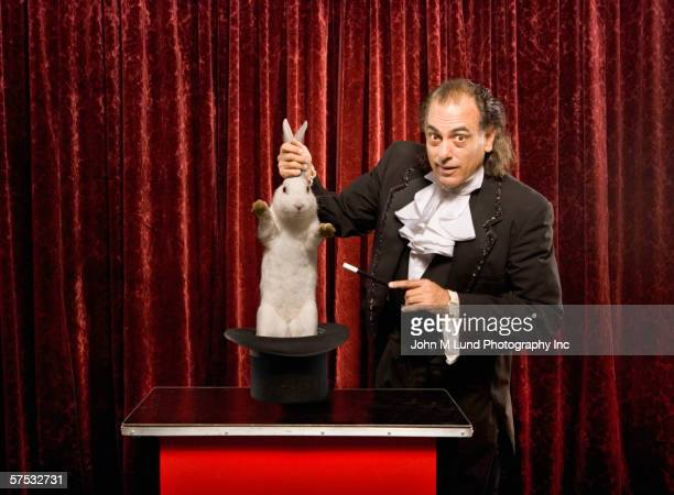Magician pulling a rabbit out of a hat