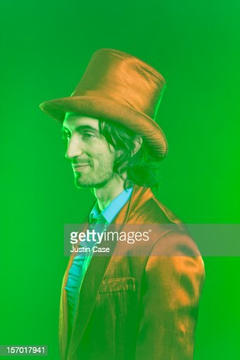A magician standing in green dusty light : Stock Photo
