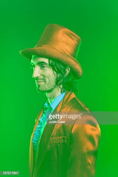 A magician standing in green dusty light