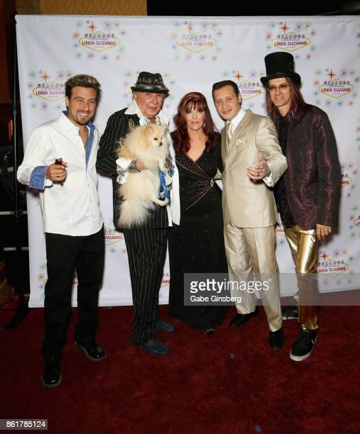 Magician Tommy Wind entertainer Monti Rock III and his dog Zozo singer Linda Suzanne entertainer David De Costa and band leader John Wakerman attend...