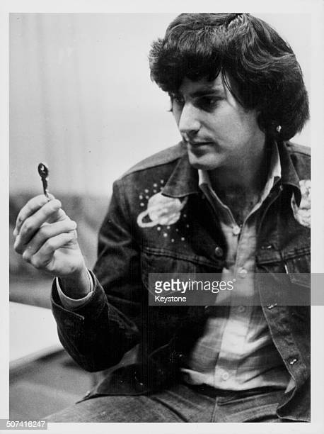 Magician Uri Geller staring at a key performing one of his tricks on television in Denmark January 30th 1974