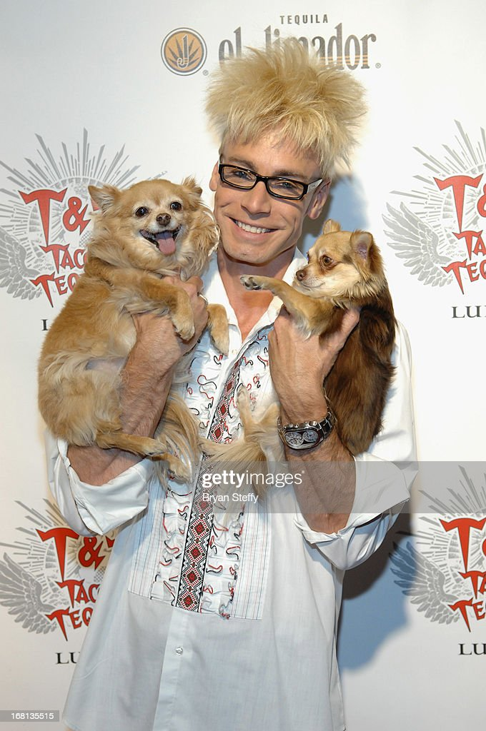 Magician/comedian Murray SawChuck and his dogs Ella (L) and Kahlua arrive at Tacos & Tequila's Cinco de Mayo celebration at the Luxor Resort & Casino on May 5, 2013 in Las Vegas, Nevada.