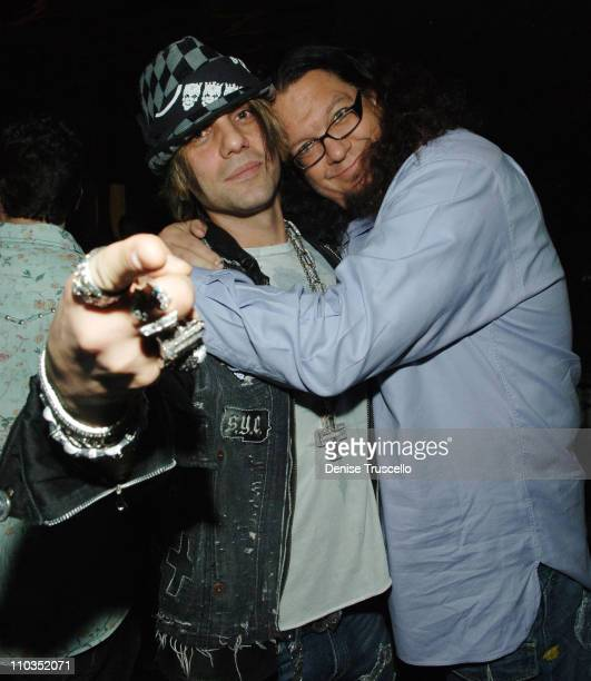 Magicians Criss Angel and Penn Jillette attend the grand opening of KOI Las Vegas at The Planet Hollywood Resort Casino on November 09 2007 in Las...