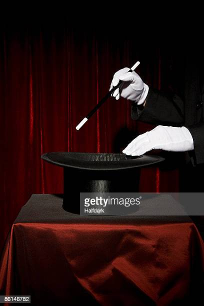 A magician's gloved hands performing a magic trick