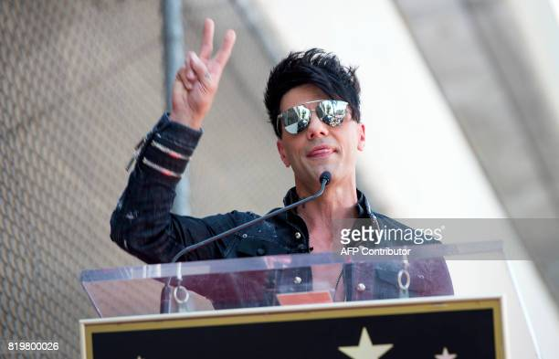 Magicien Criss Angel gestures during his star unveiling ceremony on the Hollywood Walk of Fame on July 20 in Hollywood California / AFP PHOTO /...