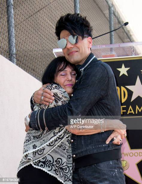 Magicien Criss Angel hugs his mother Dimitra Sarantakos during his star unveiling ceremony on the Hollywood Walk of Fame on July 20 in Hollywood...