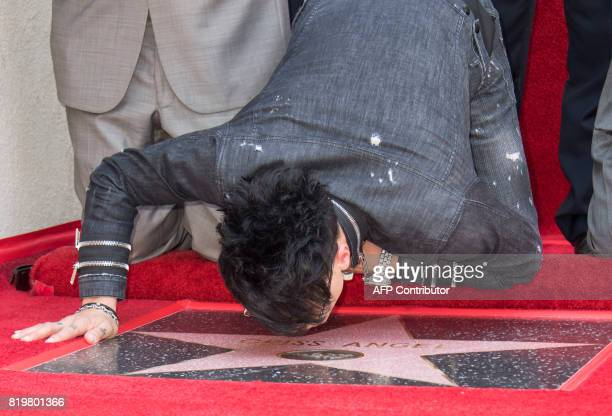 Magicien Criss Angel looks at his star during his star unveiling ceremony on the Hollywood Walk of Fame on July 20 in Hollywood California / AFP...