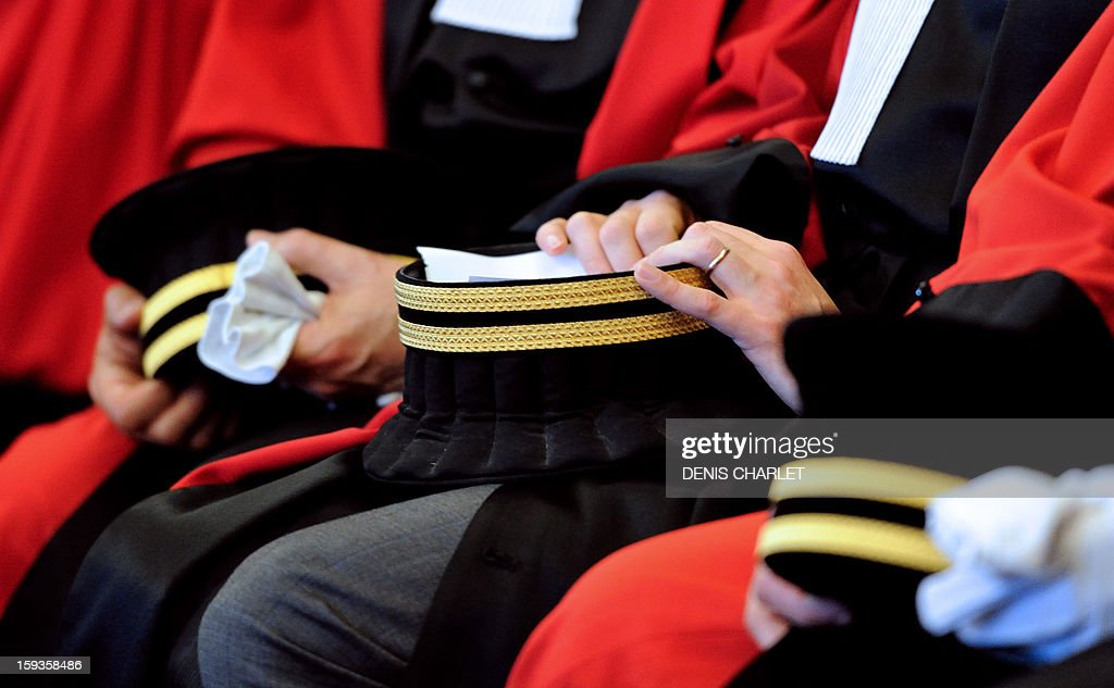 Magistrates attend a formal sitting of the appeal court in Douai, northern France, on January 10, 2013, to mark the beginning of the court's judicial year. AFP PHOTO / DENIS CHARLET