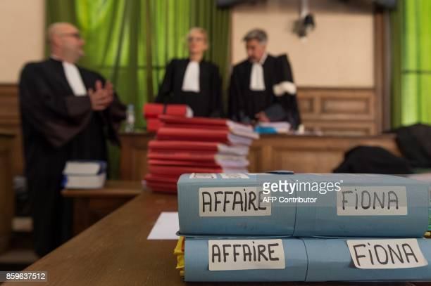 Magistrates speak together in the courthouse in Le PuyenVelay on October 10 prior to a hearing of the appeal trial of the mother and stepfather of...