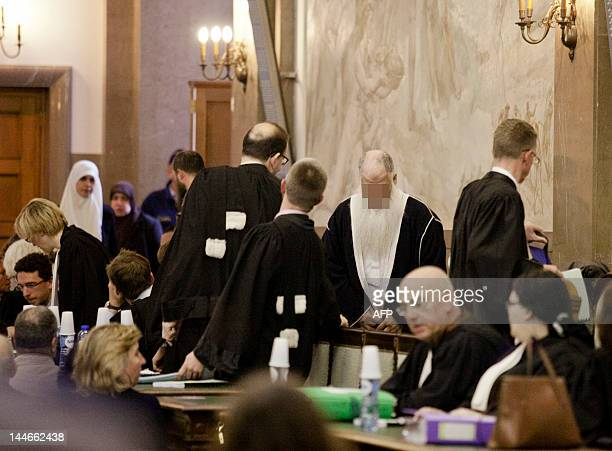 Magistrates stand as accused of the murder of Latifa Hachmi arrive at the start of their trial before the Assize Court of Brussels on May 9 2012...