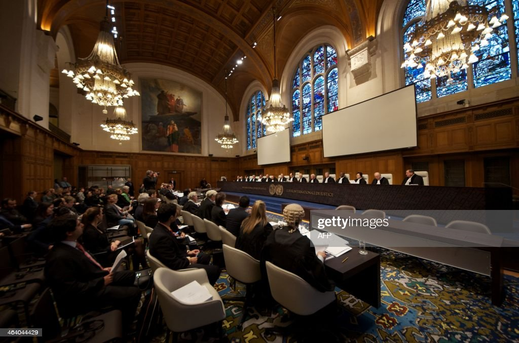 Magistrates take part in an audience of the International Court of Justice in The Hague on January 20 2014 Tiny young East Timor drags its giant...