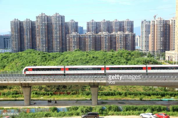 A maglev train runs on trail on August 5 2017 in Beijing China Beijing's first magnetic levitation track is under trail The 10kilometerlong track...
