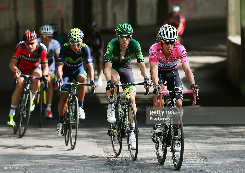 Maglia Rosa <a gi-track='captionPersonalityLinkClicked' href=/galleries/search?phrase=Rigoberto+Uran&family=editorial&specificpeople=4122792 ng-click='$event.stopPropagation()'>Rigoberto Uran</a> of Colombia and Omega Pharma-Quickstep (R) leads <a gi-track='captionPersonalityLinkClicked' href=/galleries/search?phrase=Pierre+Rolland&family=editorial&specificpeople=4112376 ng-click='$event.stopPropagation()'>Pierre Rolland</a> of France and Europcar during the fifteenth stage of the 2014 Giro d'Italia, a 225km high mountain stage between Valdengo and Plan di Montecampione on May 25, 2014 in Montecampione, Italy.