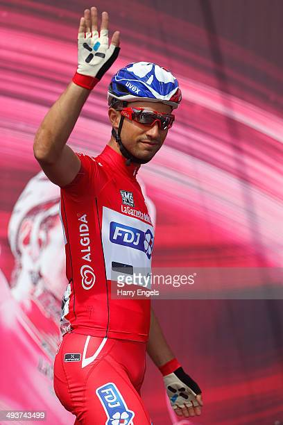 Maglia Rossa wearer and leader of the points classification Nacer Bouhanni of France and FDJfr signs on ahead of the fifteenth stage of the 2014 Giro...