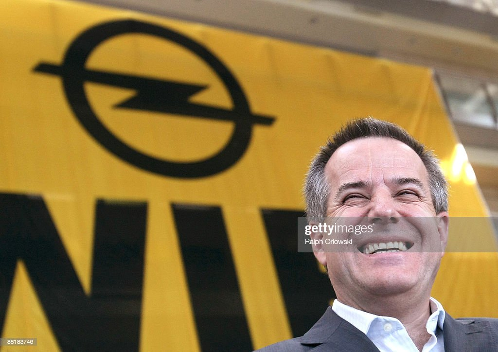Magna Co-Chief Executive Siegfried Wolf laughs in front of a huge logo of German car maker Adam Opel GmbH, a subsidiary company of U.S. carmaker General Motors at the Opel headquarters on June 3, 2009 in Ruesselsheim near Frankfurt am Main, Germany. After tough negotiations Canadian car-parts maker Magna International Inc. was chosen to rescue General Motors European division, including Opel's locations in Kaiserslautern, Eisenach, Bochum and their headquarters in Ruesselsheim with bridge loans, provided by German government.