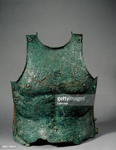 Anatomical cuirass breast plate from southern Italy end 4th century BC bronze lamina hammered and embossed 44 cm chest 38 cm Florence Ceccanti...