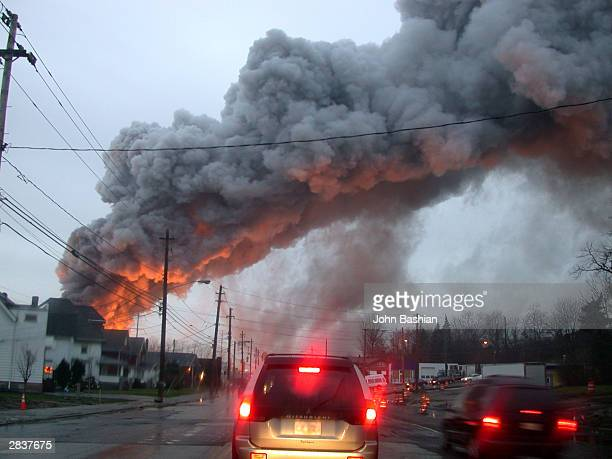 A magnesium fire at the Garfield Alloy Magnesium recycling plant continues to burn December 30 2003 in Cleveland Ohio Magnesium can explode upon...