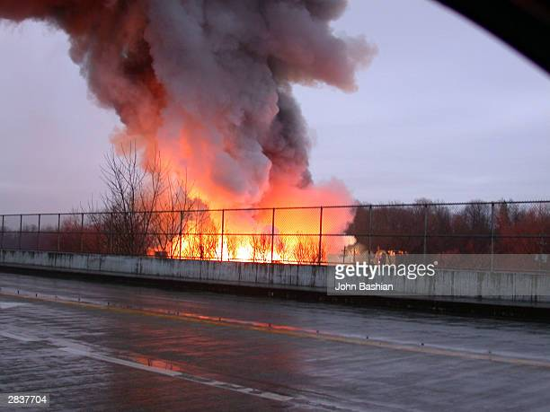 A magnesium fire at the Garfield Alloy Magnesium recycling plant continues to burn December 30 2003 in Cleveland Ohio Flames reached a hundred feet...