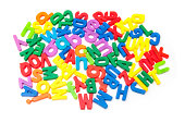 Magnetic letters on a white studio background.