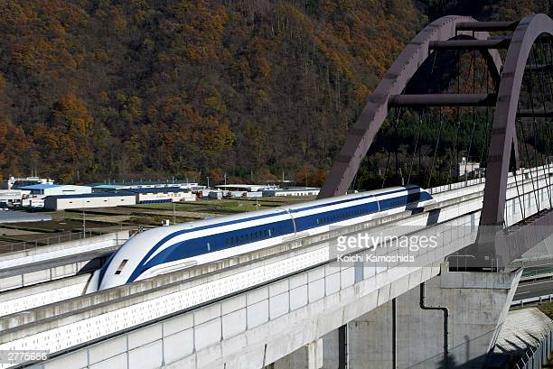 A magnetically levitated train powered by a linear induction motor sits on the track December 2 prior to setting a new world speed record during a...