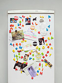 Magnets, Paintings and Photographs on a Fridge Door