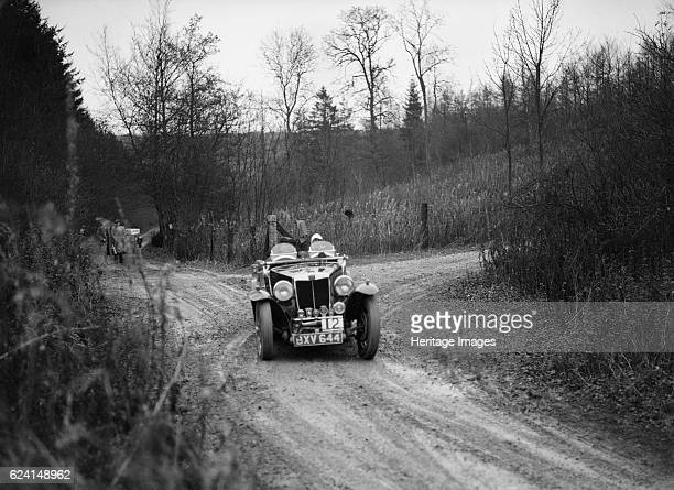 Magnette competing in the Great West Motor Club Thatcher Trophy 1938 Artist Bill BrunellMG Magnette 1935 1271 cc Vehicle Reg No BXV644 Event Entry No...
